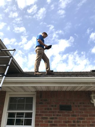 Licensed Home Inspector on the roof